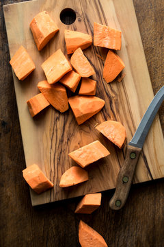 Overhead view of sweet potato slices on cutting board