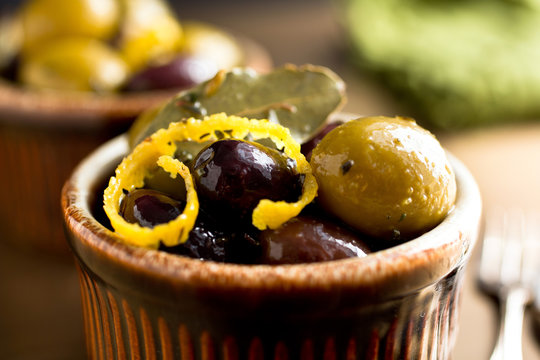 Close up of marinated olives served in bowl