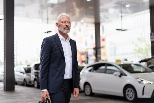 Mature businessman walking in the city
