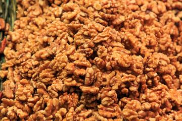 Heap of peeled walnuts in bulk at the Mercado de la Boqueria. Food concept