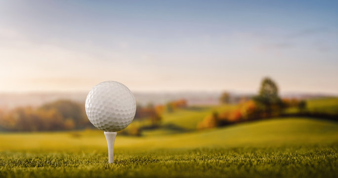 Close up of a golf ball at the golf course tee with copy space