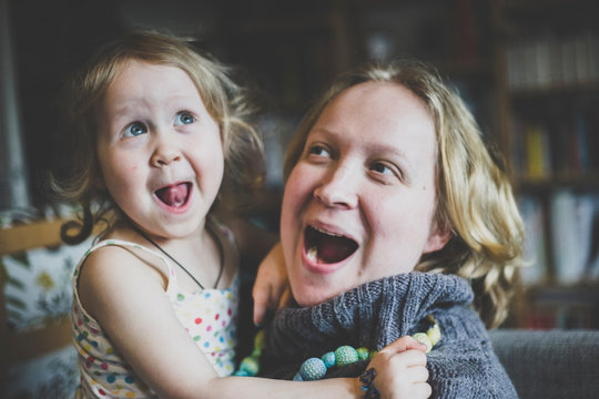Close up of mother and daughter having fun at home