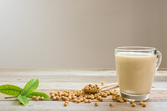 Soy milk and soy bean it on wood table background,healthy concept. Benefits of Soy.