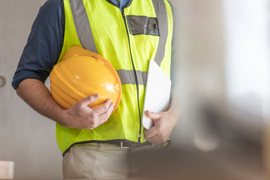 Architect with hardhat and safety vest