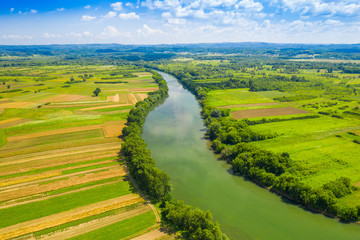Rural countryside landscape in Croatia, Kupa river meandering between agriculture fields, shot from drone Fototapete