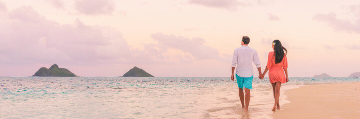 Beach vacation panoramic background romantic walk couple relaxing on Hawaii ocean summer travel destination.