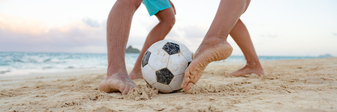 Soccer sport fun playing friends kicking ball with feet on beach panoramic banner background.