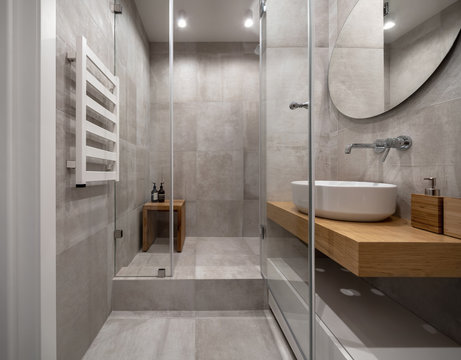 Stylish modern bathroom with light tiled walls and floor