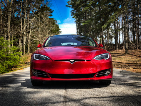 Red Tesla Model 3 on Country Road