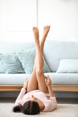 Young woman with beautiful legs at home