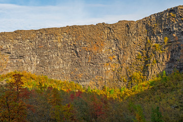 Sheer Cliffs Rise Above the Fall Colors