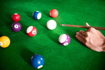 close up ofman playing a snooker or billiard in club.