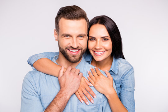 Close up photo of sweet lady and guy with toothy smile cuddling wearing denim jeans shirt isolated over white background