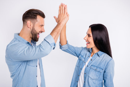 Profile side view portrait of his he her she nice attractive lovely charming cute cheerful cheery glad persons giving high-five accomplishment isolated over light white pastel background