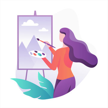 Woman artist standing at the easel and painting