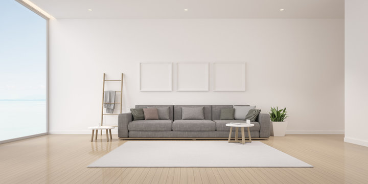 Perspective of modern luxury living room with grey sofa on sea view background, Minimal, Architecture idea of large window system. - 3D rendering.