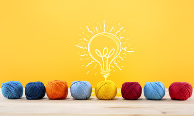 Wall Mural - Concept of idea and innovation with wool ball that shapes a lightbulb