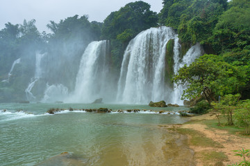 Ban Gioc or Detain waterfall flow down fluted is famous place travel destination the most popular one of the top 10 waterfalls in the world along Cao Bang, Vietnam and China border