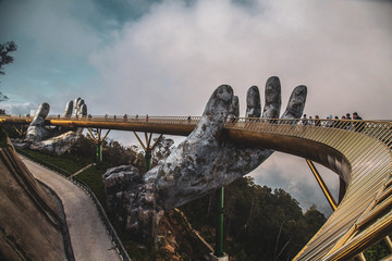 Golden bridge in Bana Hills French village, Sun World, Da Nang, Central Vietnam