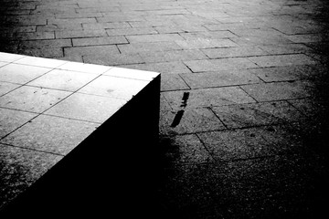 Street pavement and concrete block artistic black and white photography