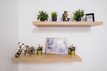 Shelves on the wall. Decorative elements.