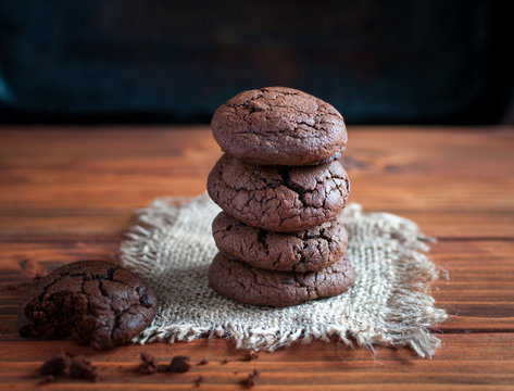 Close-up of homemade chocolate cookies on wooden background