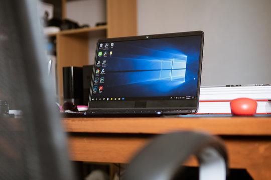 Bangkok, Thailand - July 9, 2019 : Laptop computer showing its screen with Microsoft Windows logo on desktop.
