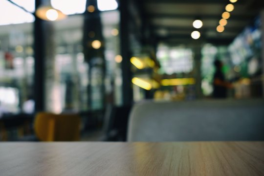 Close up Surface of Wooden Table in Cafe with Bokeh Background. (Selective Focus)