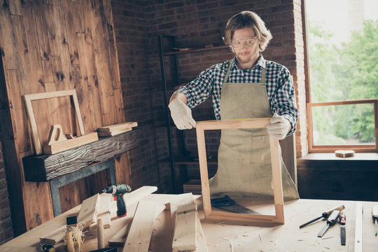 Portrait of his he nice attractive handsome blond serious focused concentrated skilled guy creating new furniture accessory at industrial brick loft style interior workplace indoors