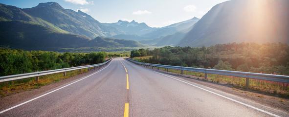 Fototapete - Highway in the mountains on the Loften Islands in Norway, beautiful landscape, sunset light