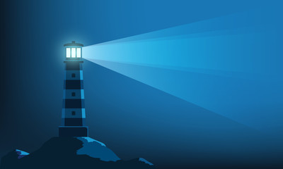 Lighthouse tower with a ray of light in the dark
