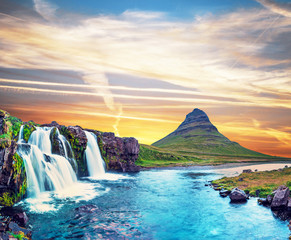 Beautiful natural magical scenery with a waterfall Kirkjufell near the volcano in Iceland. Exotic countries. Amazing places. Popular tourist atraction. (Meditation, antistress - concept).