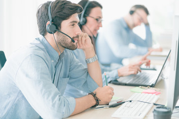 Team Business Operator in Office. Service Business, Call Center Team with Headset. The Center Appealed to Consumers to Help Identify Action Recovery Disaster.