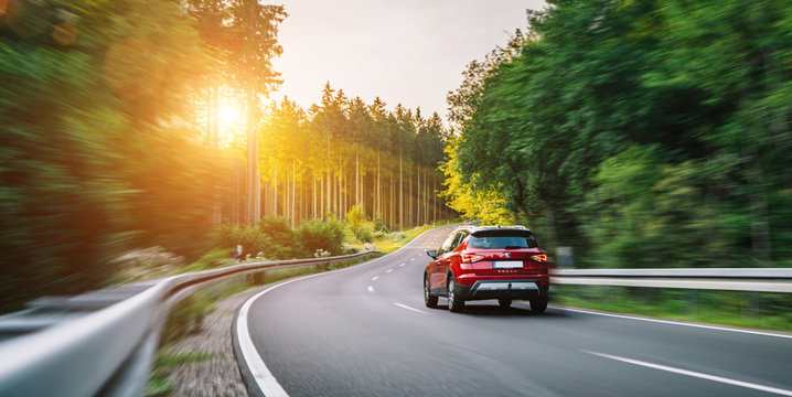 Aachen, Germany - August 26, 2019: Seat Arona small SUV car in european mountain landscape road at sunset