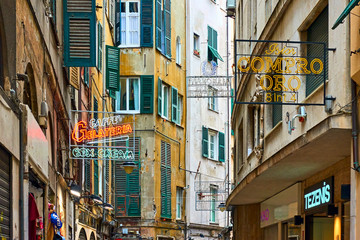Old street with signboards in Genoa