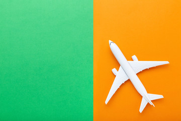 Airplane model on colorful paper background Fototapete
