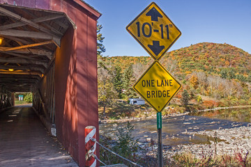 Covered Bridge Entrance with Hill and River