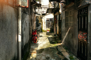 Spoed Foto op Canvas Smal steegje Around chinese hutongs in Guangzhou city, which are a type of narrow streets or alleys in typical neighborhoods with old houses.