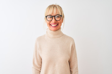 Middle age woman wearing turtleneck sweater and glasses over isolated white background with a happy...