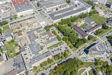 aerial view of industrial district with factories, plants and warehouses