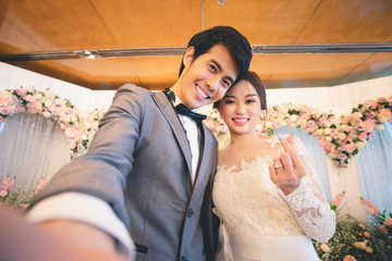 Bride and groom selfie photo at wedding ceremony..