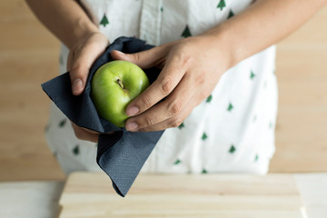 Hand cleaning green apple Wall mural