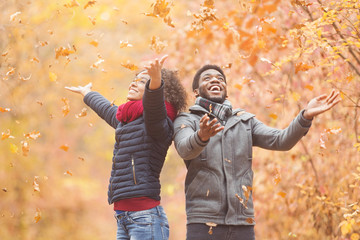 African-american couple spending fun time in autumn park Wall mural