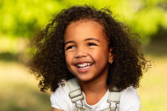 Playful little girl having fun in the park