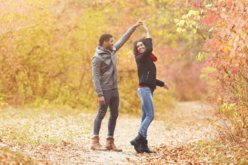 Printed kitchen splashbacks Dance School Young afro couple dancing in autumn park, having fun