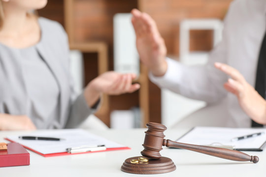 Judge's gavel on table in  office. Concept of divorce