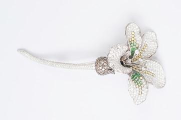 flower shaped brooch on whtie background