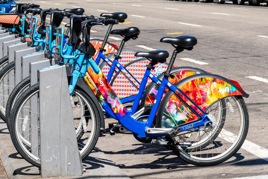 Aug 21, 2019 San Francisco / CA / USA - Colorful Bay Wheels (formerly Ford GoBike) bicycles parked at a station; Motivate (the Company operating the bicycles) was acquired by Lyft at the end of 2018