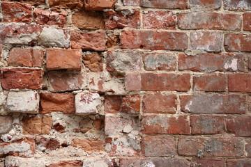 Old broken brick wall background