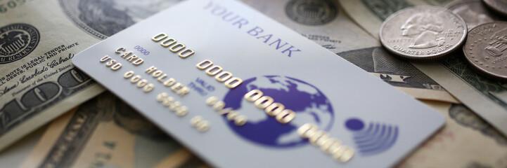 Banking plastic card lying on big amount of US money closeup Fototapete